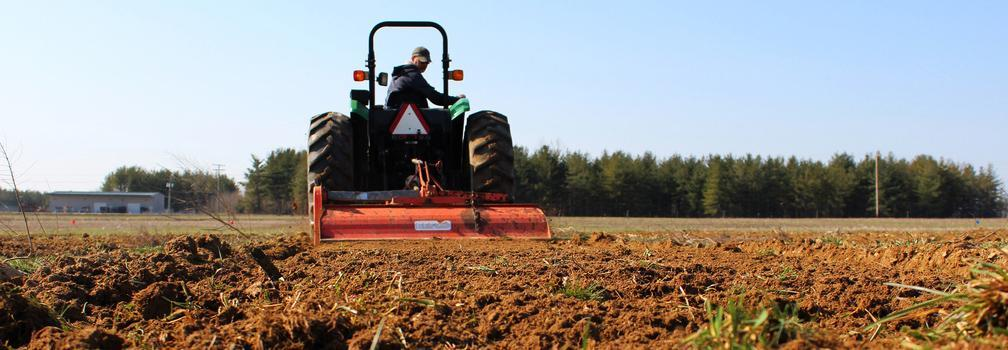 Tractor preparing a field