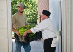 Farmer delivering produce to chef